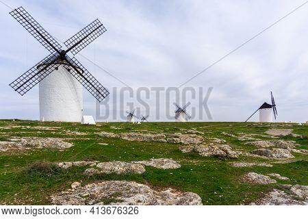 A View Of The Historic White Windmills Of La Mancha Above The Town Of Campo De Criptana