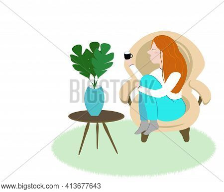 Rest, A Cozy Home, A Comfortable Apartment. A Red-haired Girl Sits In An Armchair And Drinks From A