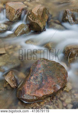 A Red Rock Sits In Parfrey's Glen Creek, Parfrey's Glen State Natural Area, Sauk County, Wisconsin