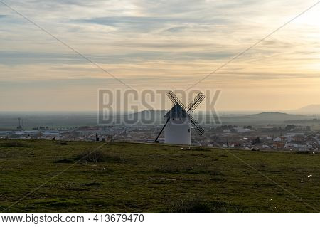 A Whitewashed Spanish Windmill In Campo De Criptana In Warm Evening Light