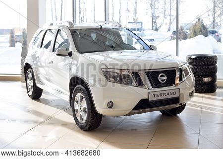 Russia, Izhevsk - February 19, 2021: Nissan Showroom. New Modern Terrano Car. Front And Side View. F
