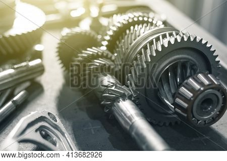 Shafts With Gears Of A Gearbox On A Table In A Car Service. Close Up