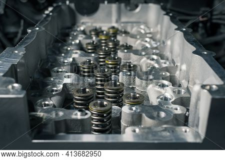 Installation New Cylinder Head On A Old Diesel Engine. Motor Assembly In A Car Workshop. Close Up.