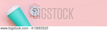 Simply Flat Lay Design Blue Paper Coffee Cup And Alarm Clock Isolated On Pink Pastel Background. Tak