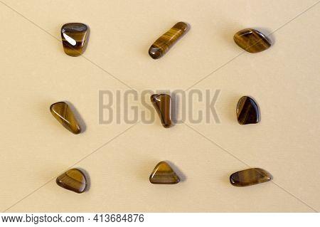 Natural Mineral Gem Stone Tiger's Eye Tigers Eye, Tiger Eye Gemstone Isolated On Beige Background Cl