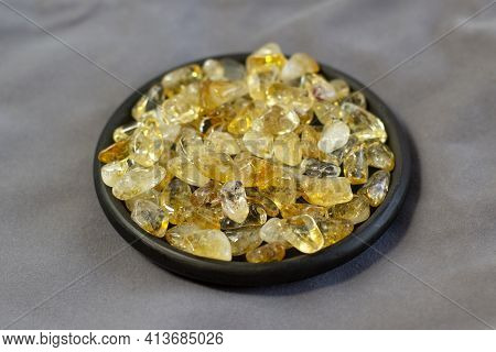 Citrine Yellow Gem Geode Crystals Geological Mineral On Black Plate As Nice Background Close Up Top
