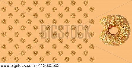Donut Pattern. Donut Pattern On A Pastel Beige Background. Chocolate Donuts Pattern. Flat Lay.