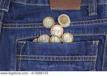 Money In Your Pocket. Coins In Pocket Jeans. The Concept Of Pocket Money. Cash. Business Concept