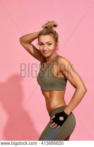 Strong Woman In Sportswear With Perfect Sporty Body