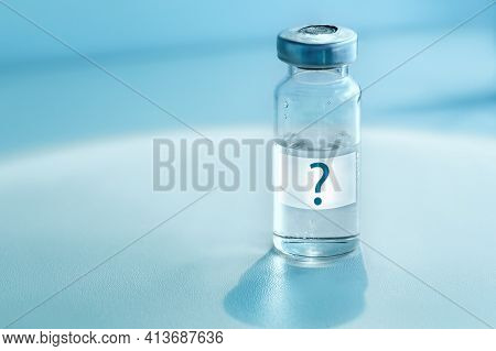Medical Ampoule On A Blue Background. Vaccination Concept. Question Mark On Glass Medical Vial. Medi