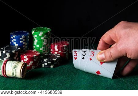 Poker Cards With Three Of A Kind Or Set Combination. Close-up Of A Gambler Hand Is Holding Playing C