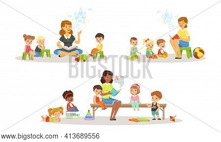 Teacher Reading Book To Kids In Kindergarten Set, Boys And Girls Listening To Fairy Tale In Classroo