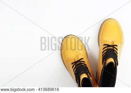 Stylish, Bright, Yellow, Rubber, Rain Boots Close-up On A White Background. Autumn Style Concept, Co