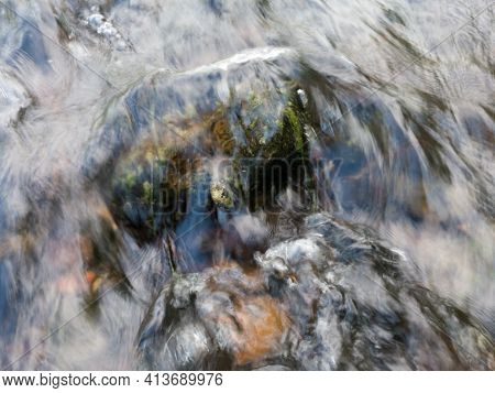 Wavy Rippling Turbulent Water Surface Of Rapids In Stream, Hydro Energy, Shallow Creek Flows Over  S