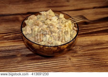 Salad With White Kidney Beans, Potatoes, Chicken Meat, Eggs And Mayonnaise On Wooden Table