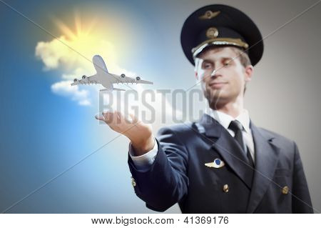 Image of pilot with airplane taking off from his hand poster