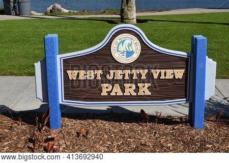 NEWPORT BEACH, CALIFORNIA - 22 FEB 2017: West Jetty View Park sign on the Balboa Peninsula.