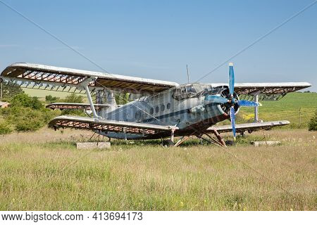 Abandoned Old Airplane On The Field. Biplane
