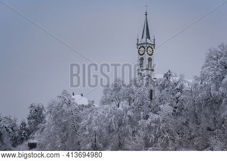 Church Like A Castle In A Fairytale On Snow Caped Hill With Frosty Forest. Church Of Rein At Ruefena
