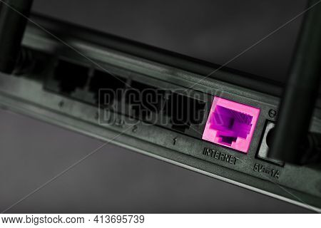 A Pink Patch Cord Is Inserted Into The Router's Wi-fi Port To Access The Internet. Internet Connecti