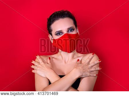 Woman With Bright Manicure Dressed Protective Red Face Mask On Red Background