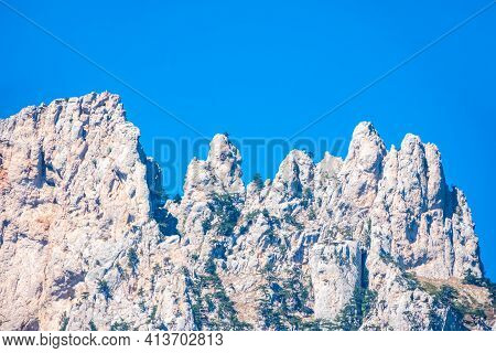 High Mountains With Forested Slopes And Peaks On Blue Sky Background. Crimea Mountains On A Bright D
