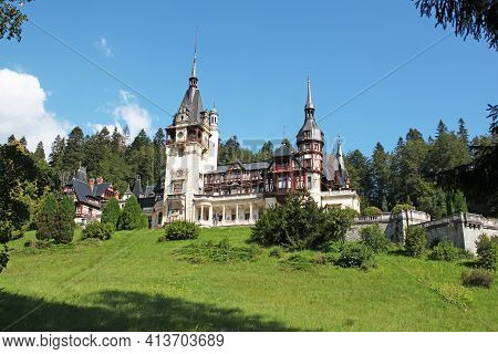 Sinaia, Romania - 08.22.2020: Peles Castle In Sinaia City, Surrounded By Green Forest. Located On Pr