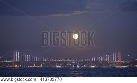 Sea Landscape With Shining City On Background Of Evening Sky With Moon. Action. Beautiful Coast On H