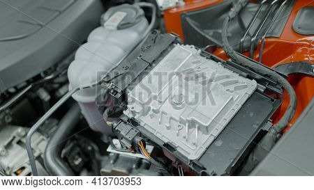 Close-up Of Inside Of Car Under Hood. Action. Powerful Engine Under Hood Of New Car. Inside Of New B