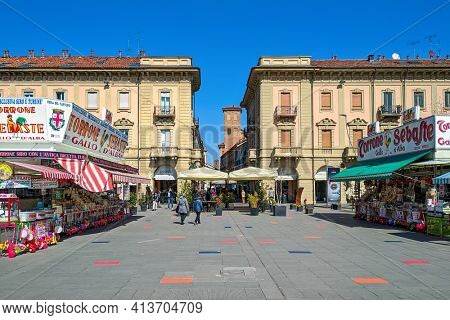 ALBA, ITALY - MARCH 13, 2021: Sebaste mobile stalls selling torrone and other traditional sweets on piazza Ferrero in Alba - small town in Piedmont, famous for white truffles and wine production.