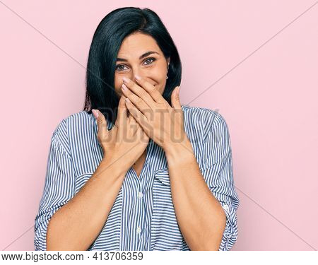 Young caucasian woman wearing casual clothes laughing and embarrassed giggle covering mouth with hands, gossip and scandal concept