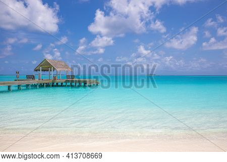 Overwater Bungalow In The Indian Ocean. Amazing Nature Sea Horizon With Turquoise Lagoon With Cloudy