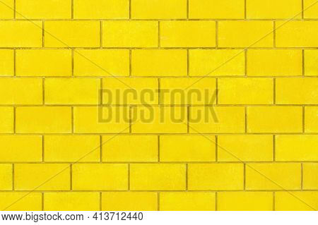 Yellow Paint On A Bright Brick Blocks Urban Color Wall Texture Background.