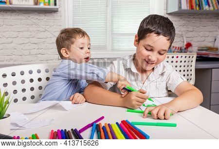 Children Are Painting In Kindergarten. Kids Draw In Creativity At Home Together. Cute Boys Studying