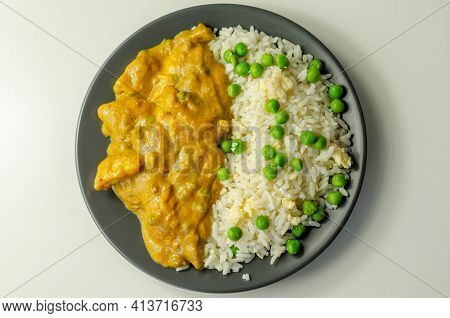 Chicken Breast Pieces In A Mildly Spiced Coconut Curry Sauce With Fried Rice With Peas And Egg