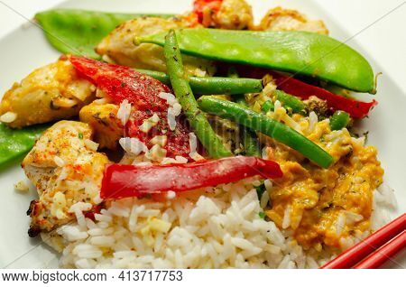 Chicken Breast Pieces In A Thai Red Curry Sauce Made With Coconut Cream, Red Chillies, Lemongrass, L