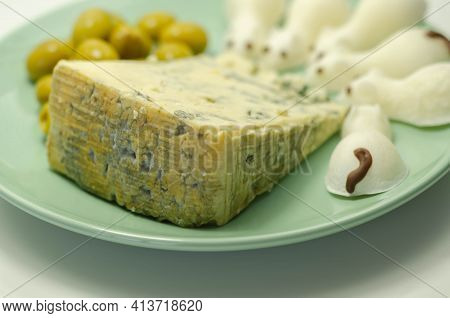 Full Fat Soft Blue Veined Cheese With Olives And Snacks In The Shape Of Mice