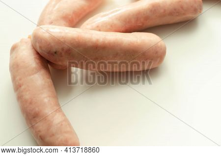 Raw Classic British Sausage Made From Prime Cuts Of Pork On The White Background