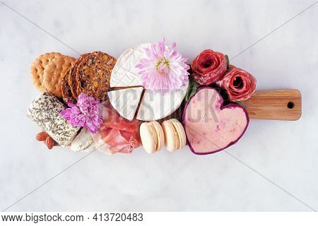 Mother's Day Theme Charcuterie Board Against A White Marble Background. Variety Of Cheese, Meat, Fru