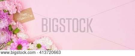 Happy Mothers Day Gift Tag With Corner Border Of Pink And White Flowers. Overhead View On A Pink Ban