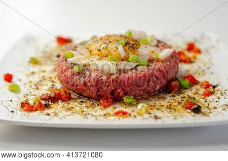 Beef Steak Tartare With Raw Egg Yolk And Onion With Tomato