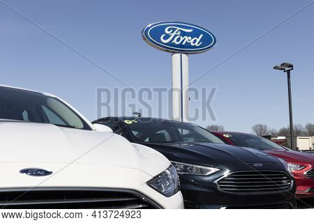 Fishers - Circa March 2021: Ford Fusion Display At A Dealership. Ford Sells Traditional Gasoline, El