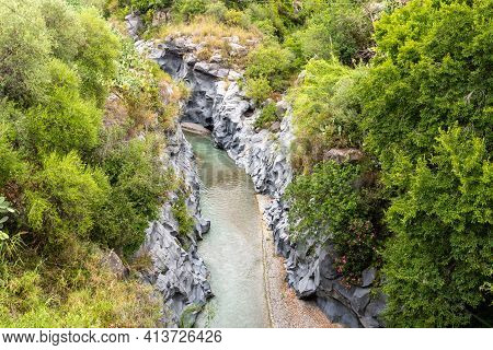 Basalt Rocks And Pristine Water Of Alcantara Gorges In Sicily, Italy
