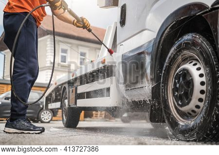 Caucasian Worker In His 40s Power Washing His Commercial Vehicle Towing Truck Inside Manual Car Wash