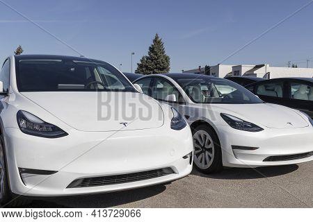 Indianapolis - Circa March 2021: Tesla Electric Vehicles Awaiting Preparation For Sale. Tesla Produc