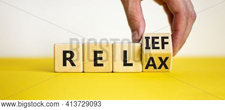 Relief And Relax Symbol. Businessman Turns A Cube And Changes The Word 'relax' To 'relief'. Beautifu
