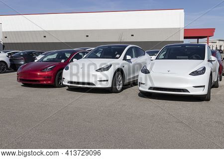 Indianapolis - Circa March 2021: Tesla Electric Vehicles Awaiting Preparation For Sale. Tesla Produc