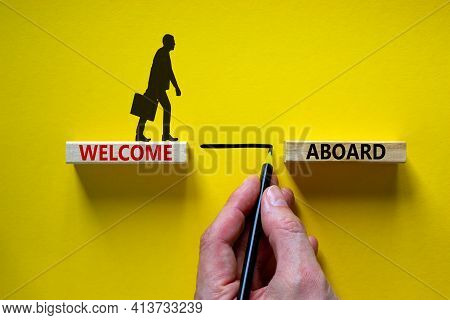Welcome Aboard Symbol. Wooden Blocks With Words 'welcome Aboard'. Businessman Hand. Beautiful Yellow