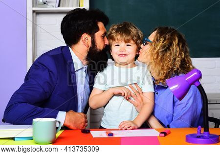 Happy Parents Kissing Little Son. Family Schooling Together. Children Education. Parenting.