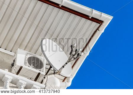 Satellite Antenna Transmitting Signal Next To The Air Conditioning Under The Roof Of The Hotel Again